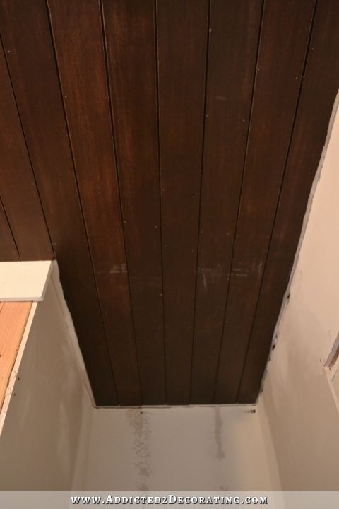 stained wood slat ceiling in hallway bathroom - 2