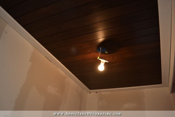 stained wood slat ceiling in hallway bathroom - 3