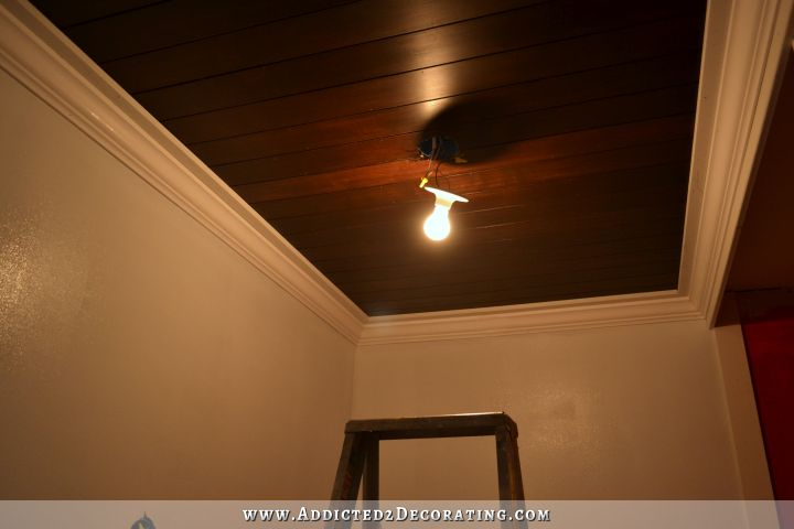 stained wood slat ceiling in hallway bathroom - 4