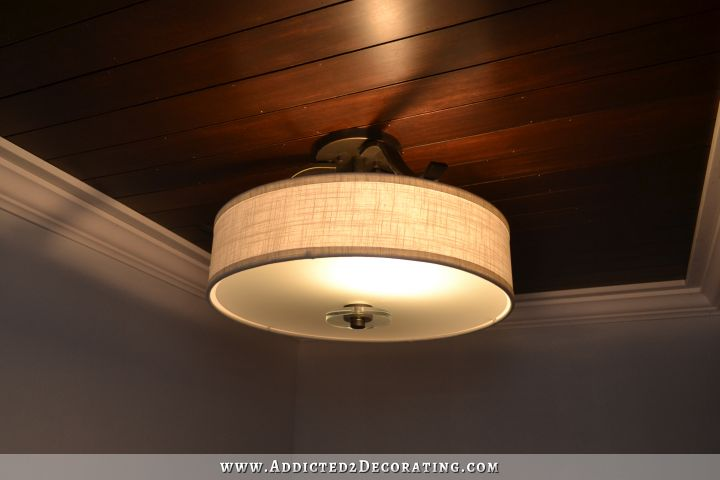 stained wood slat ceiling in hallway bathroom - 5