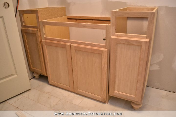 Furniture style bathroom vanity made from stock cabinets for Bathroom cabinet ideas furniture