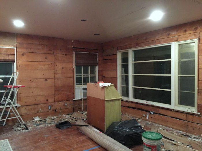 dining room with old drywall removed and shiplap exposed - 2