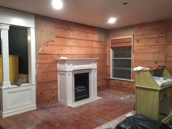 dining room with old drywall removed and shiplap exposed