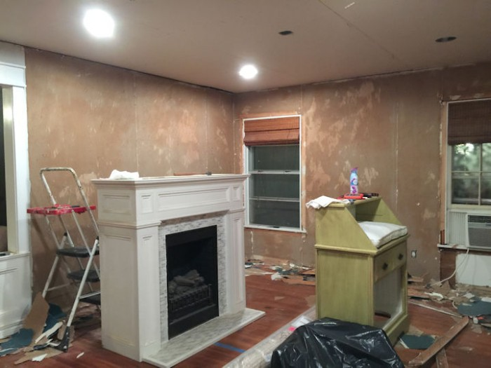 dining room with old drywall scraped and ready to be skim coated