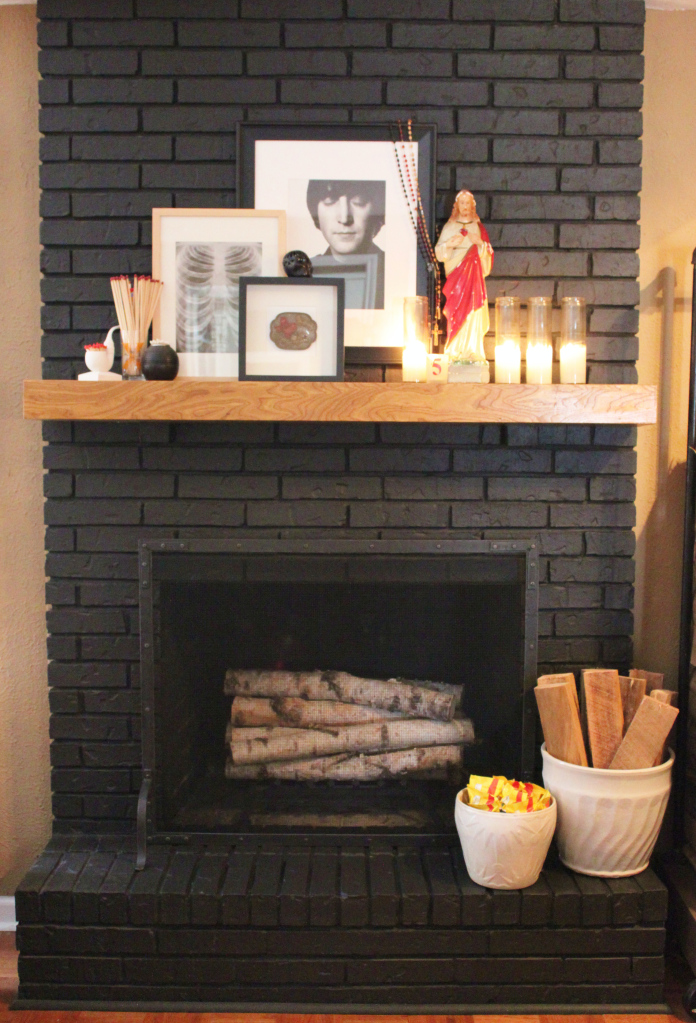 black painted fireplace via the cavender diary