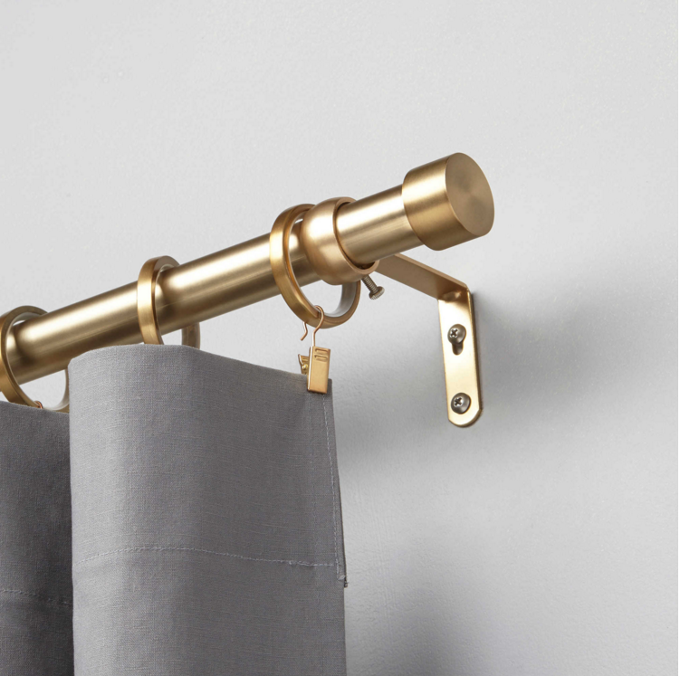 umbra curtain rod in brushed brass from bed bath beyond