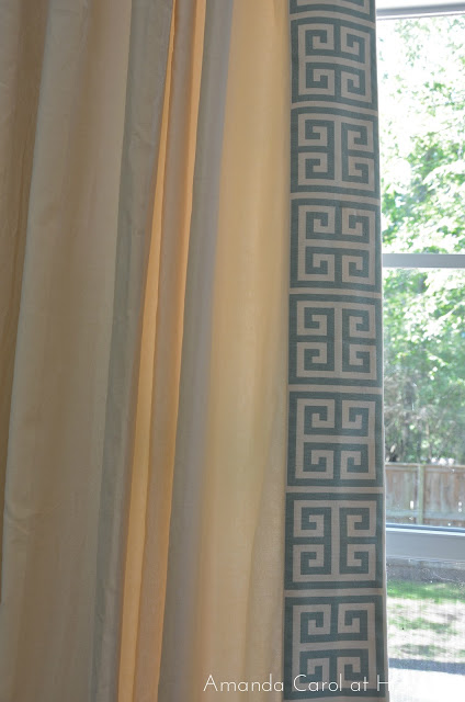 white curtains with bue and cream greek key trim on leading edge, from Amanda Carol Interiors blog