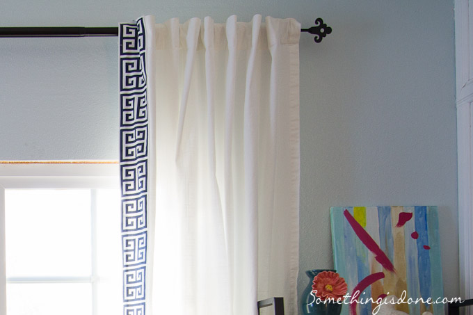 white curtains with navy blue and white greek key trim from Something Is Done blog