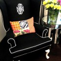 black chair with white piping, by Anna Spiro of Black and Spiro in Australia, via Design Sponge