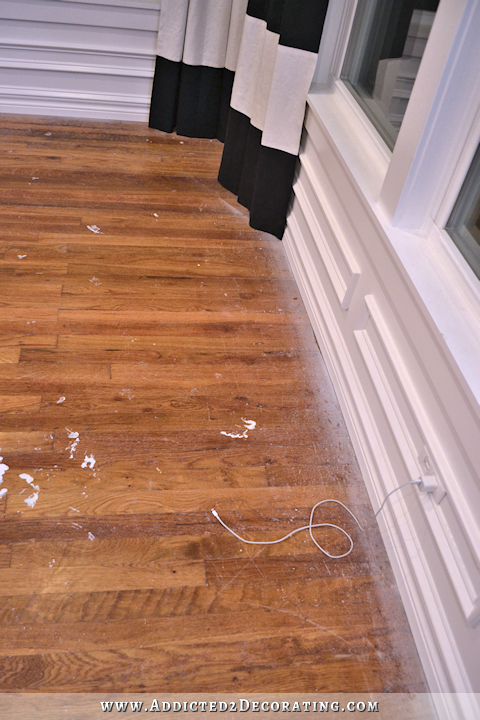 hardwood flooring with paint overspray and spills - 1