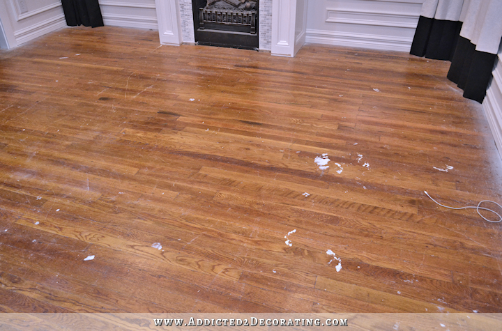 hardwood flooring with paint overspray and spills - 2