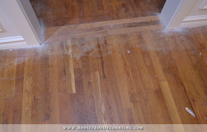 hardwood flooring with paint overspray and spills - 3