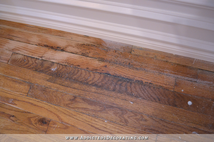 hardwood flooring with paint overspray and spills - 4