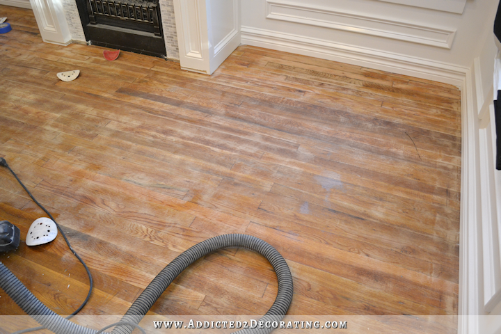 hardwood flooring with paint overspray and spills - sanding with 80-grit sandpaper - 1
