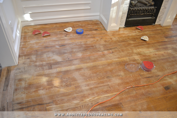 hardwood flooring with paint overspray and spills - sanding with 80-grit sandpaper - 2