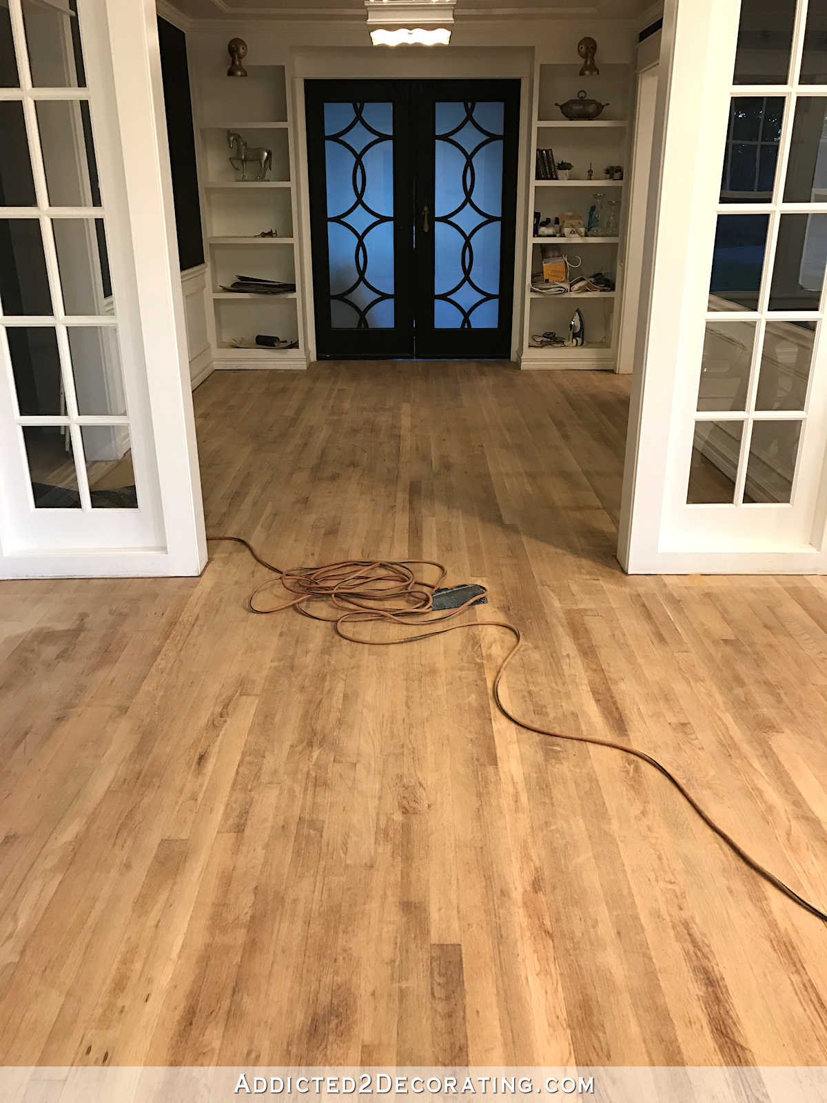 Red oak hardwood floors sanded before staining entryway to music room