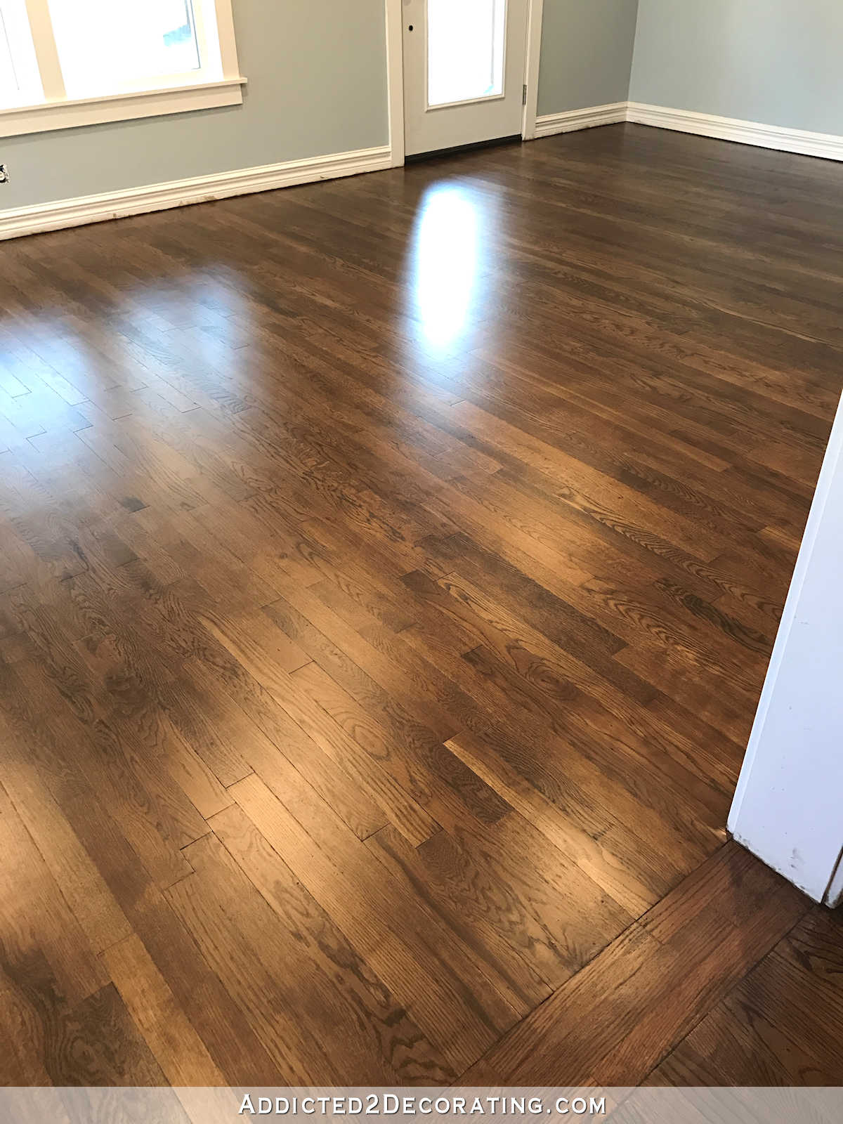Refinished red oak hardwood floors living room and entryway