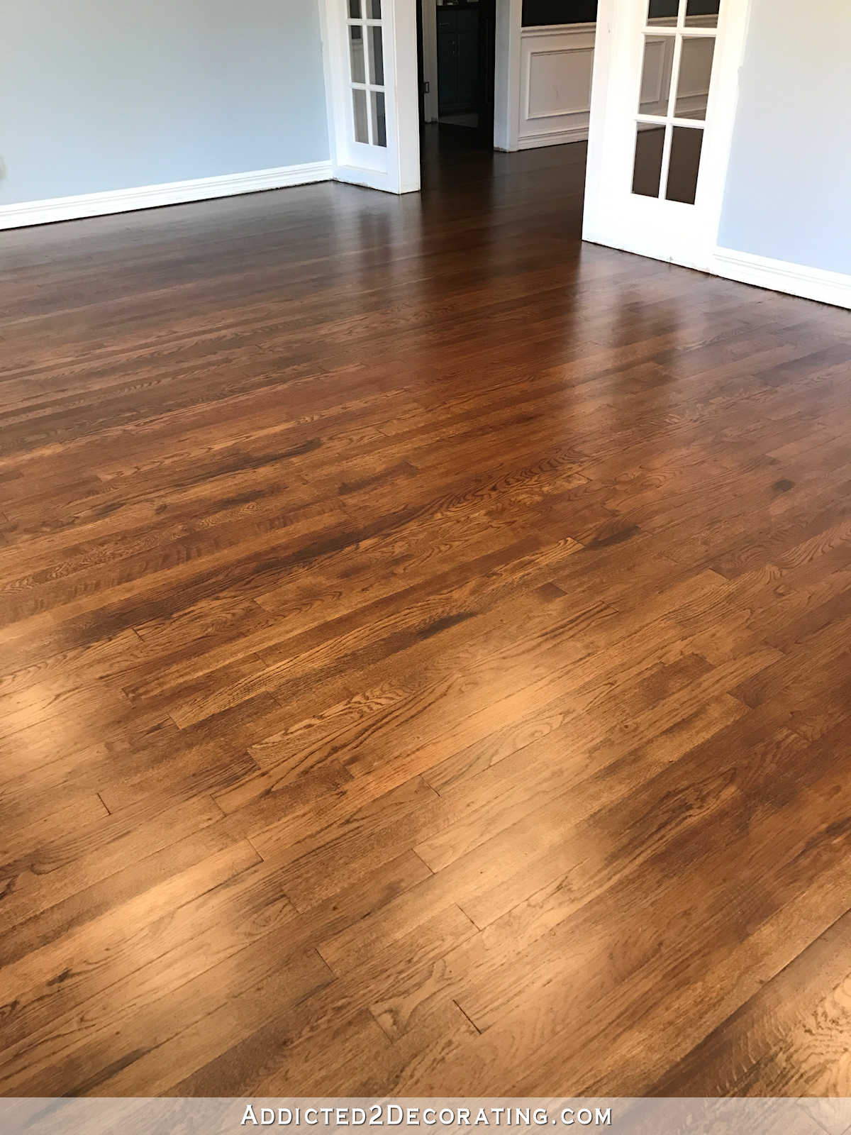 Refinished red oak hardwood floors living room entryway and music room