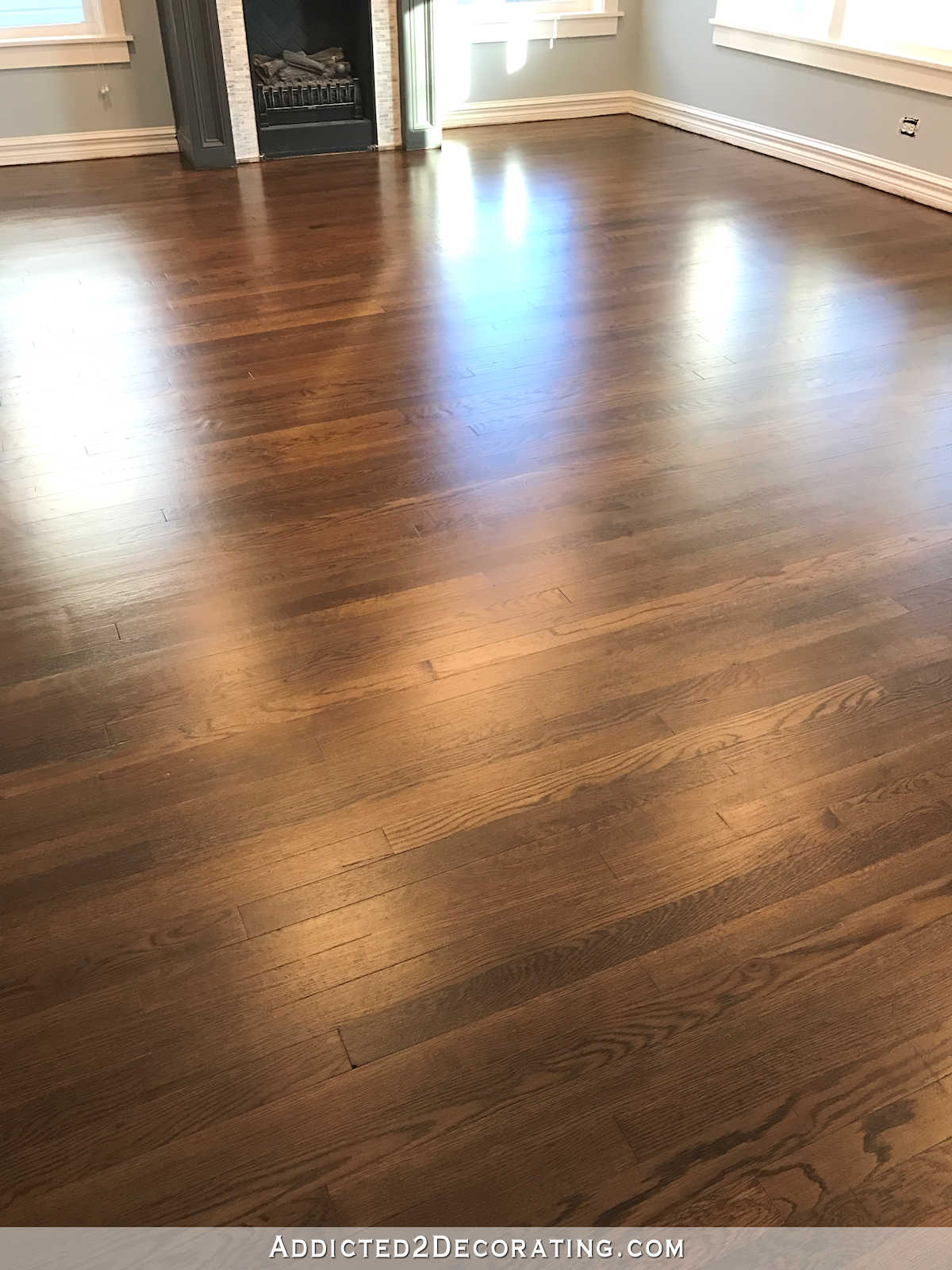 Refinished red oak hardwood floors living room