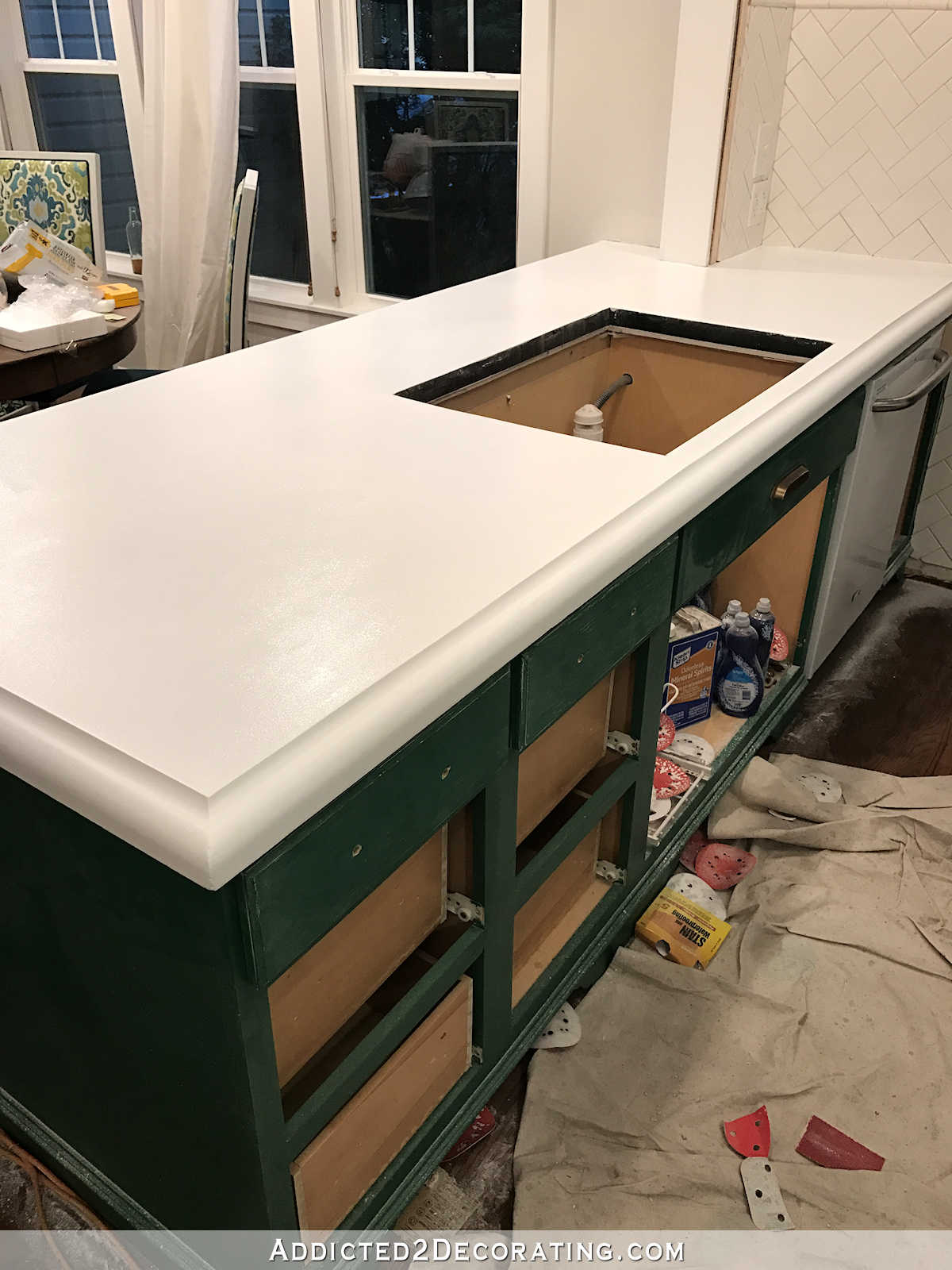 refinishing concrete countertops - 19 - concrete countertop with two coats of Sherwin Williams High Reflective White paint