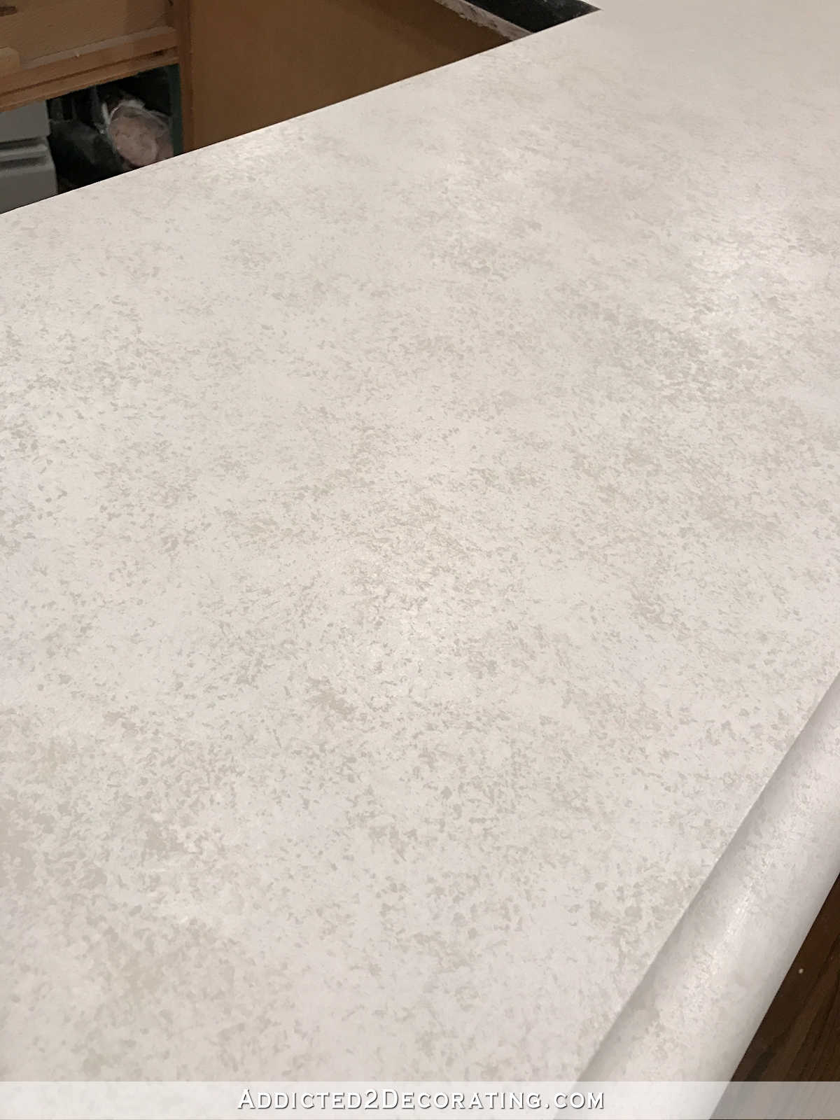 refinishing concrete countertops - 23 - second coat of sponged paint in Behr Polar Bear