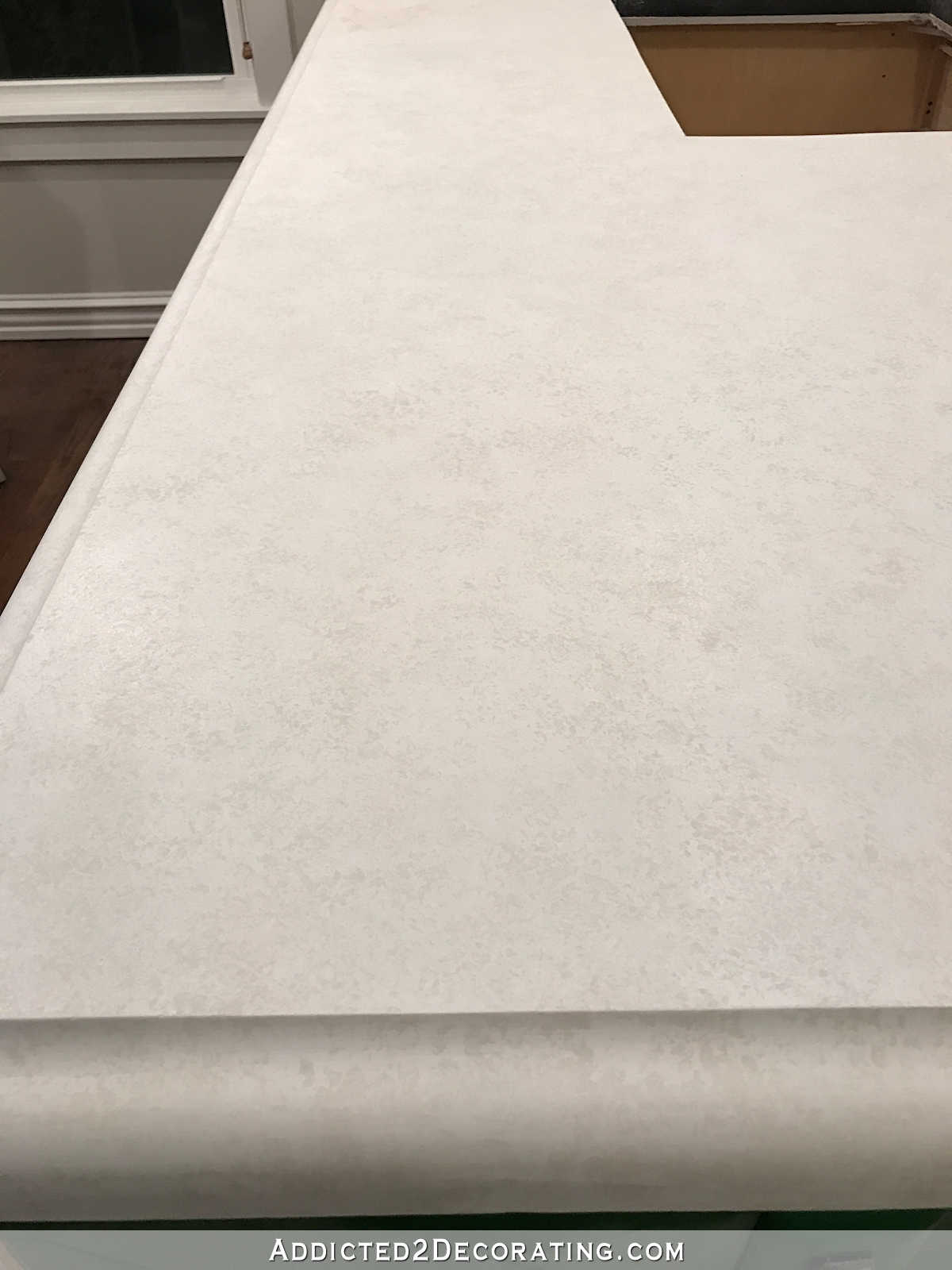 refinishing concrete countertops - 24 - third coat of sponged paint in Sherwin Williams Snowbound