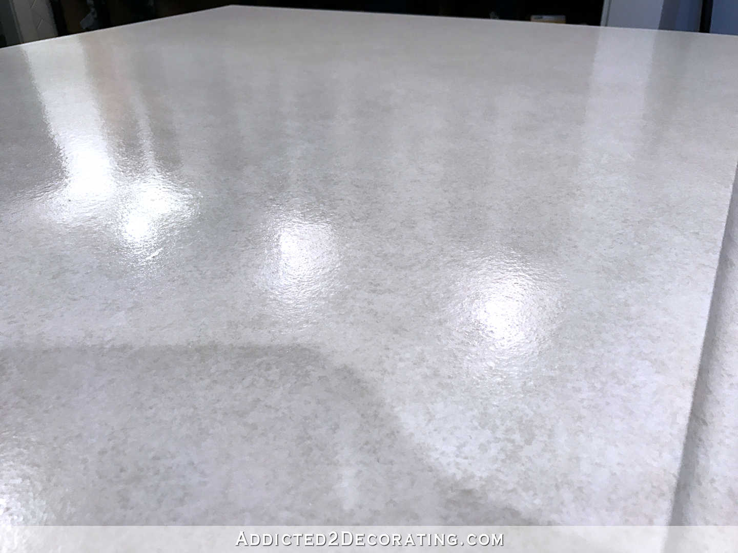 refinishing concrete countertops - 42 - finished counteretop with the clear coat polyurea sealer - peninsula close up