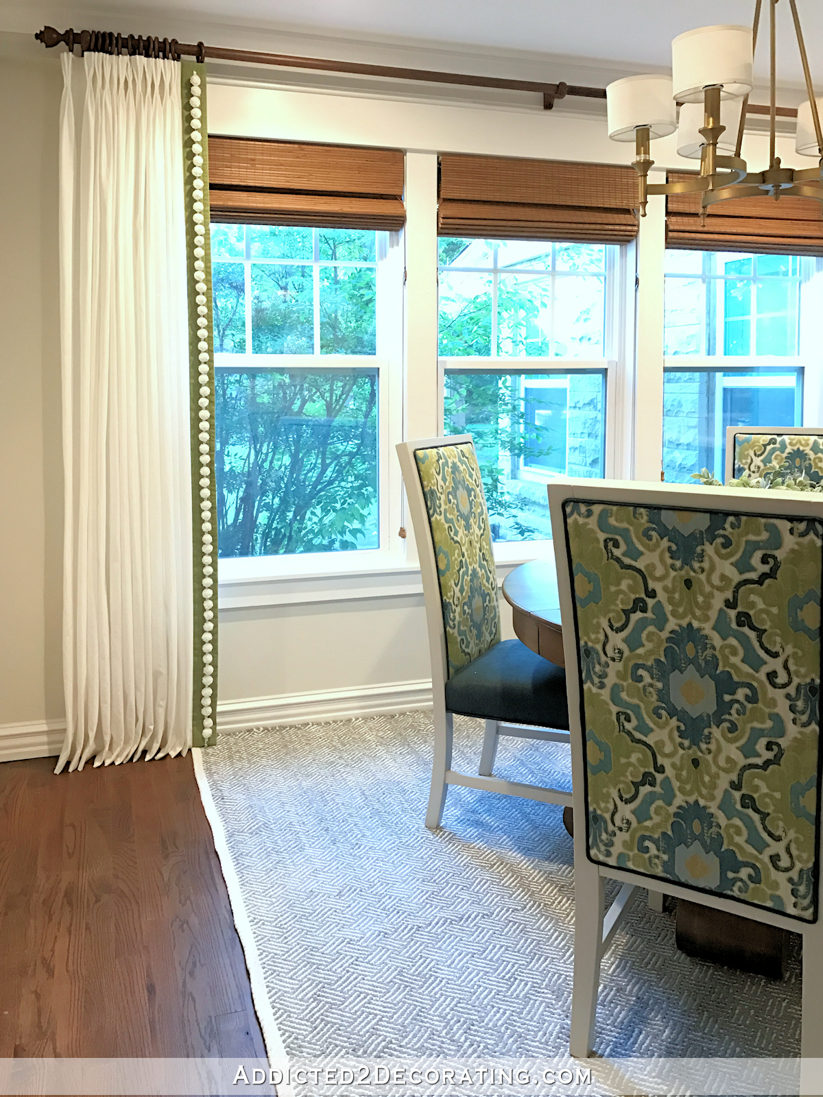 breakfast room with finished curtains and peninsula - 3