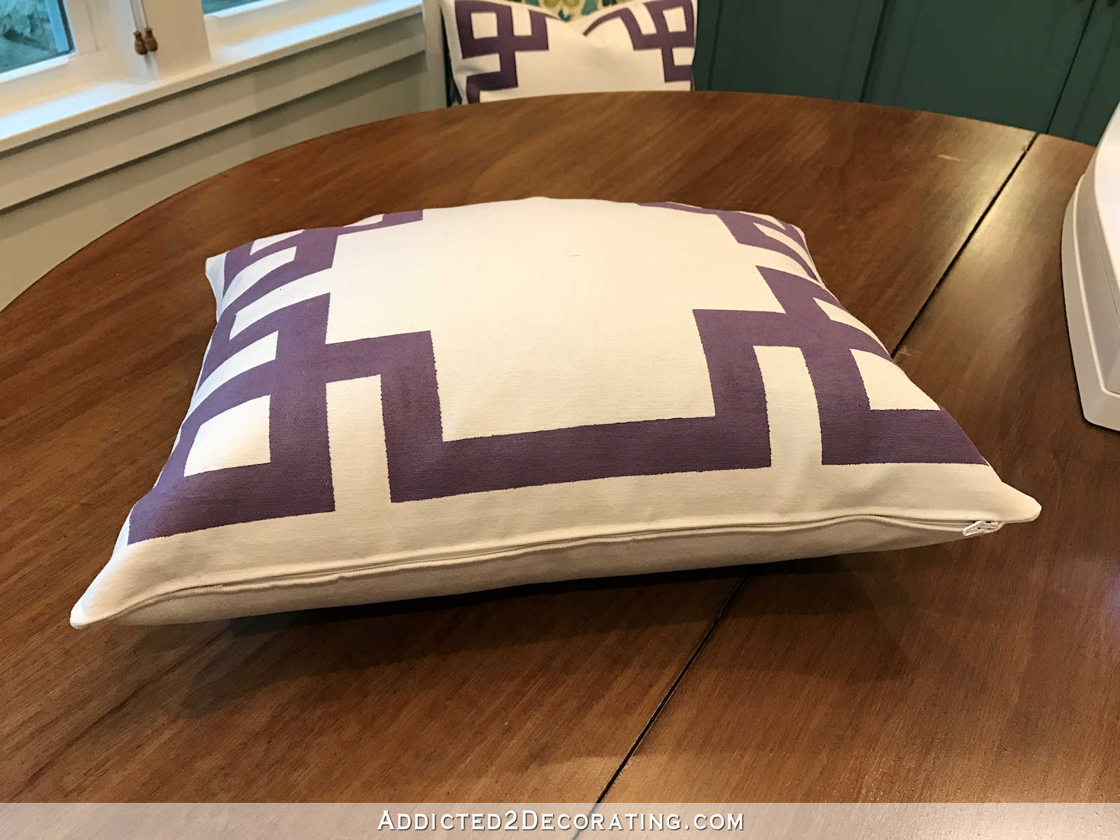 easy DIY Greek key throw pillow using painters stape and paint - 14