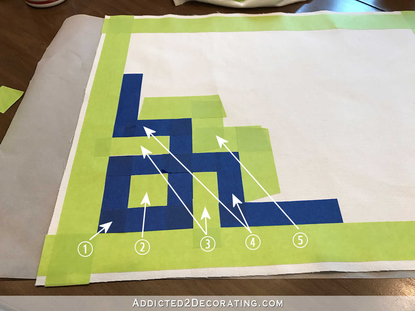 easy DIY Greek key throw pillow using painters stape and paint - 3