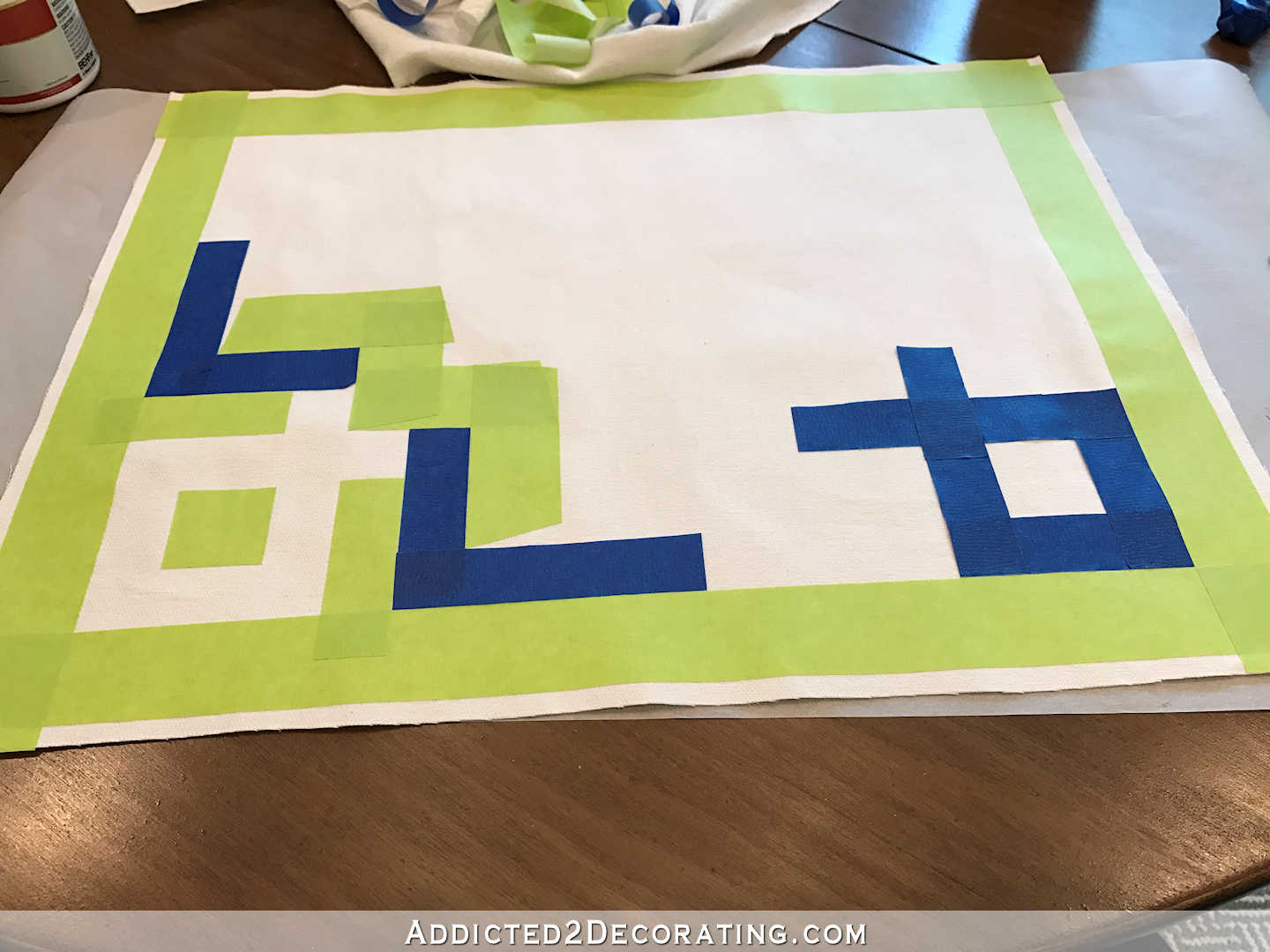easy DIY Greek key throw pillow using painters stape and paint - 4