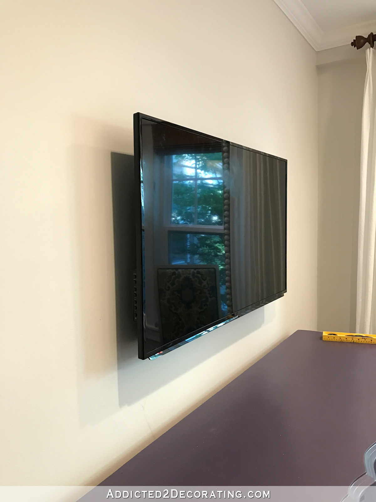 how to build an easy DIY frame for a wall mounted flat screen tv - 15 - TV mounted on wall with low profile mounting hardware