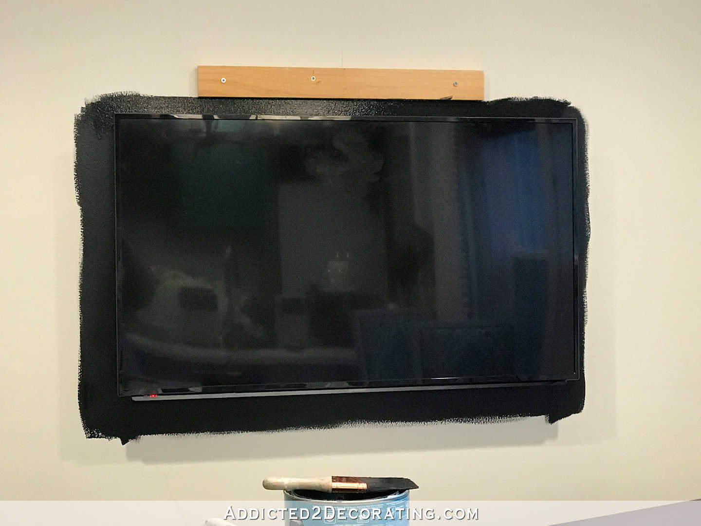 how to build an easy DIY frame for a wall mounted flat screen tv - 17 - attach mounting boards to wall and paint black frame around the tv