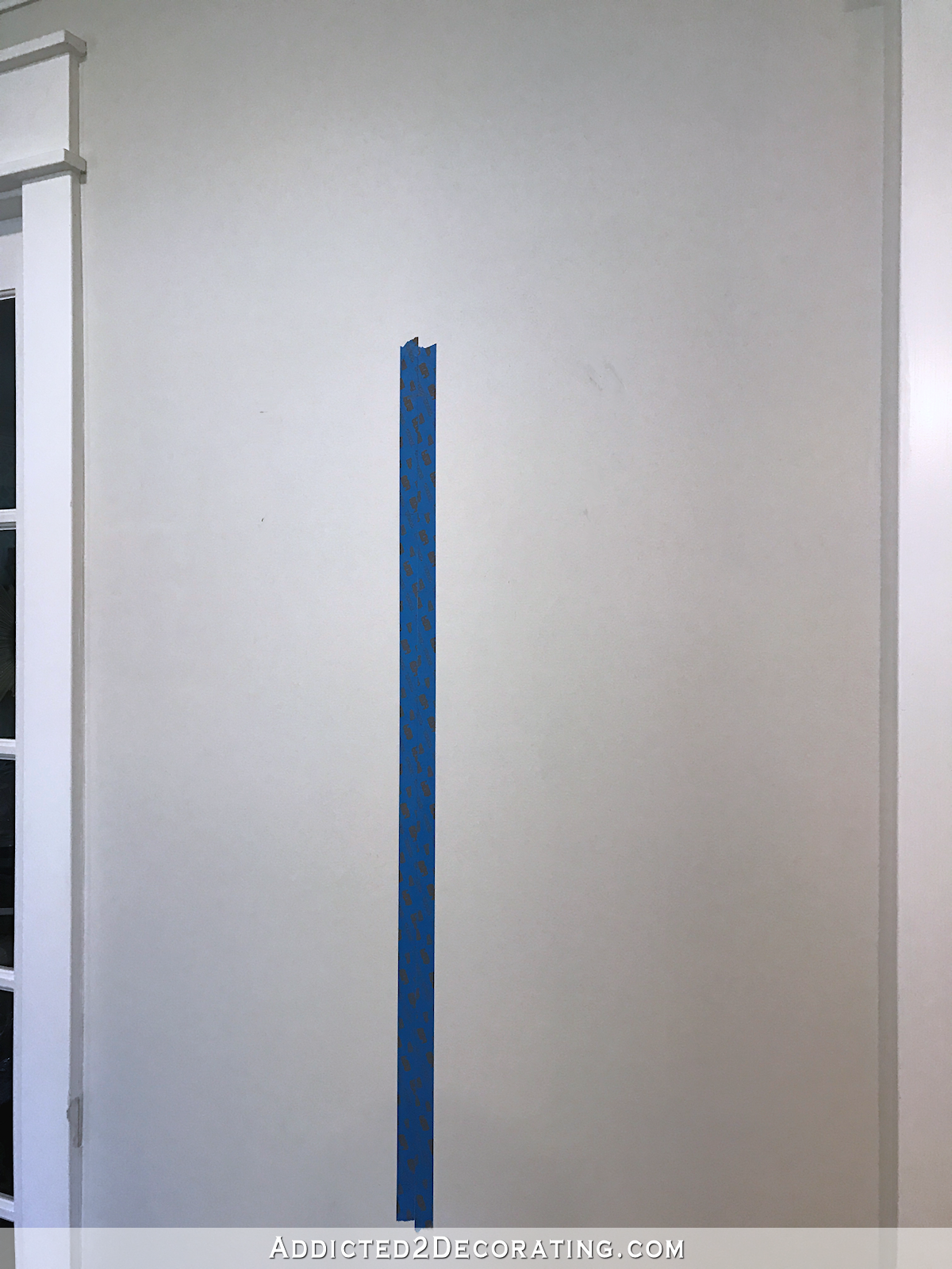 how to hang a perfect gallery wall - use painters tape to mark a grid on the wall - 1