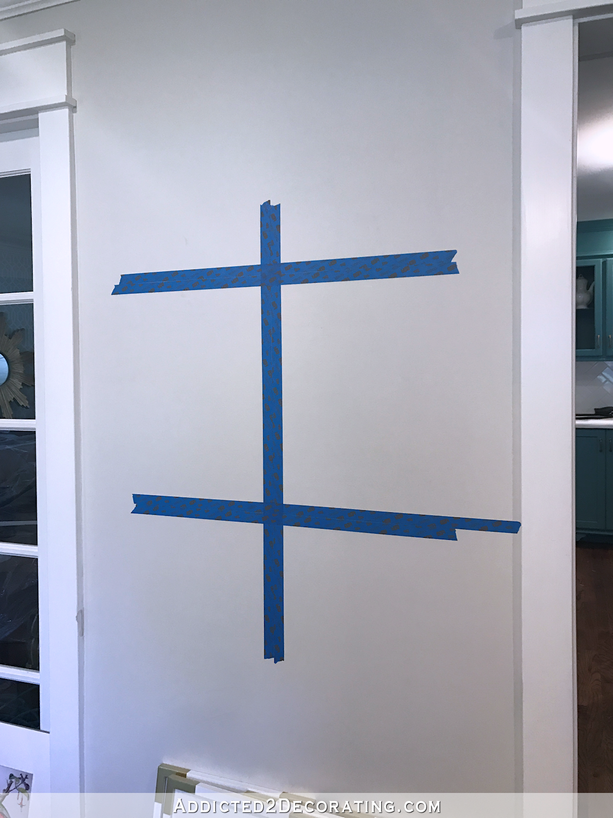 how to hang a perfect gallery wall - use painters tape to mark a grid on the wall - 2