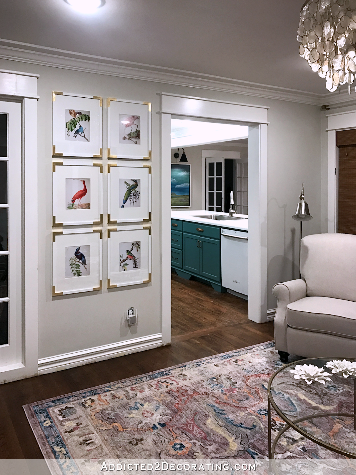 living room gallery wall with colorful bird illustrations - 1