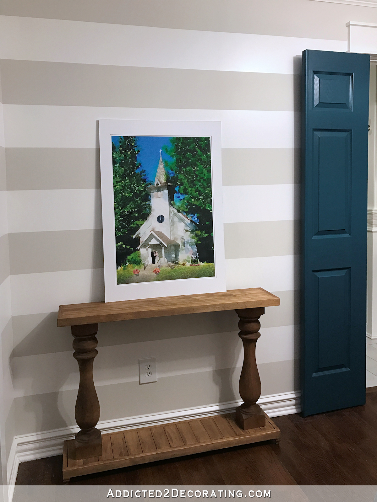 watercolor chapel pic in hallway with console table