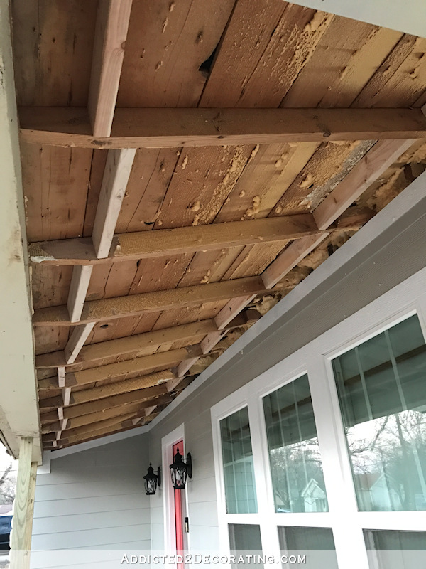 Front porch ceiling with exposed rafters before pine tongue and groove boards were installed