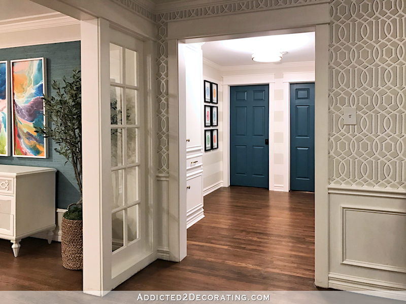 hallway after remodel - view from music room, teal doors, custom linen cabinet
