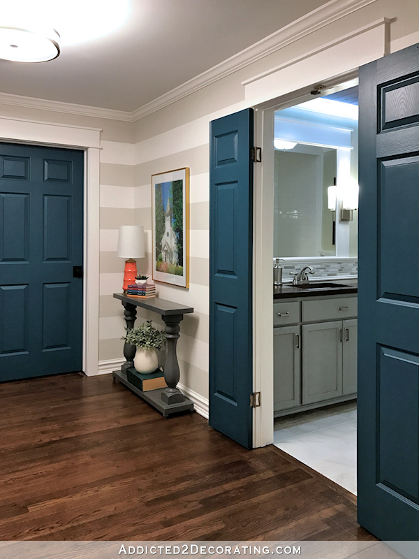 hallway after remodel - view into hallway bathroom with teal doors and gray vanity
