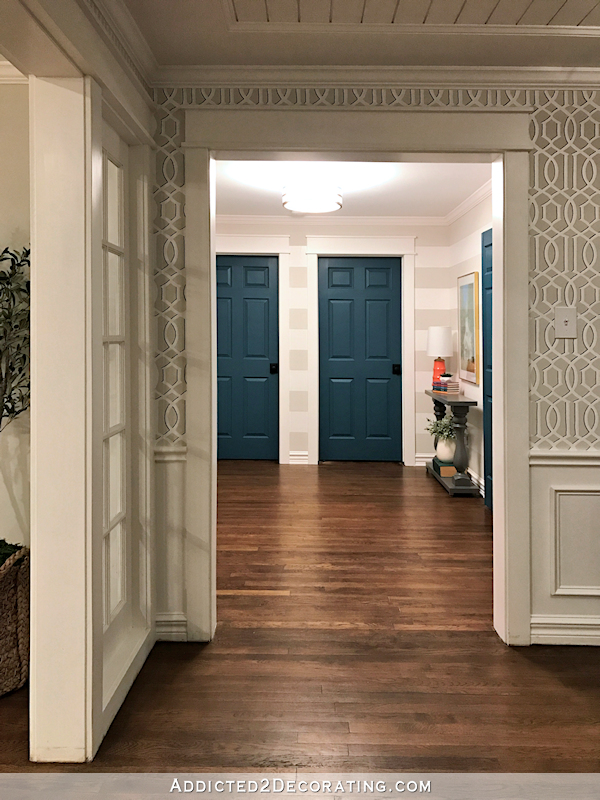 hallway after remodel - teal doors, striped walls, view from music room