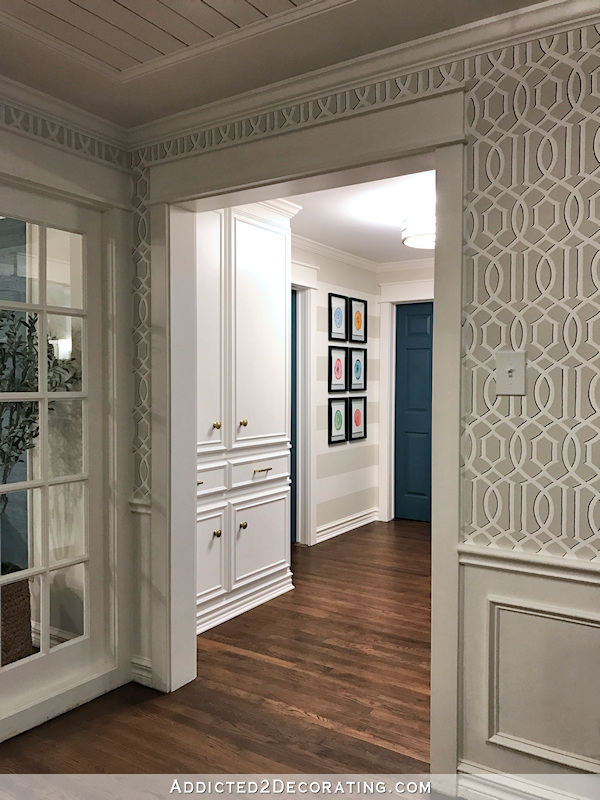 hallway after remodel - custom built-in linen cabinet, view from music room