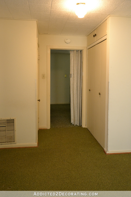 hallway before remodel - closets on both sides of cased opening