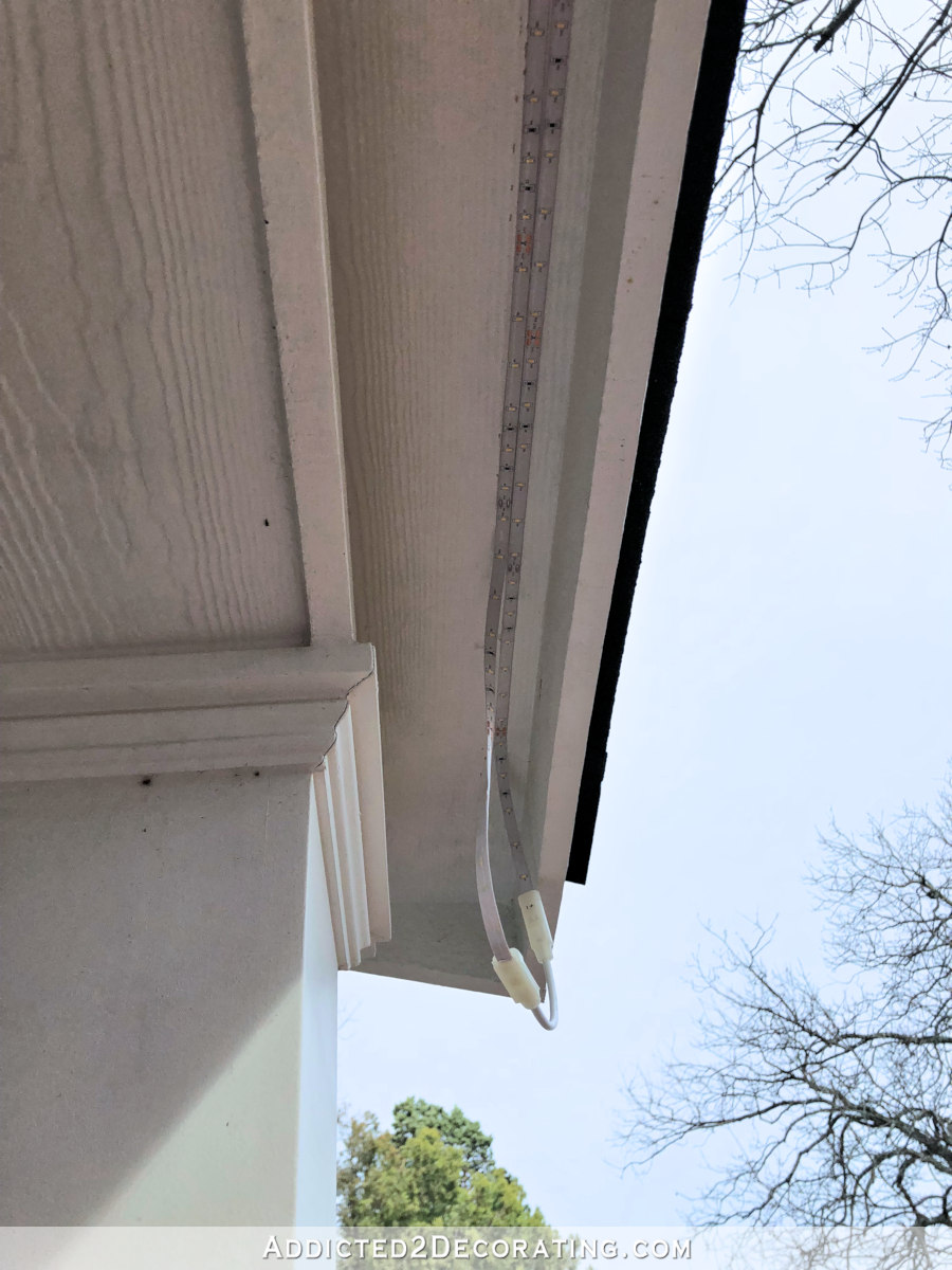 LED tape lights outdoors - two strips spliced together using a connector and installed just behind fascia board at front of porch roof.