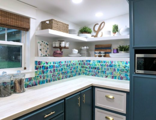 Butler's pantry remodel with dark teal lower cabinets, floating corner shelves, and whitewashed wood countertop