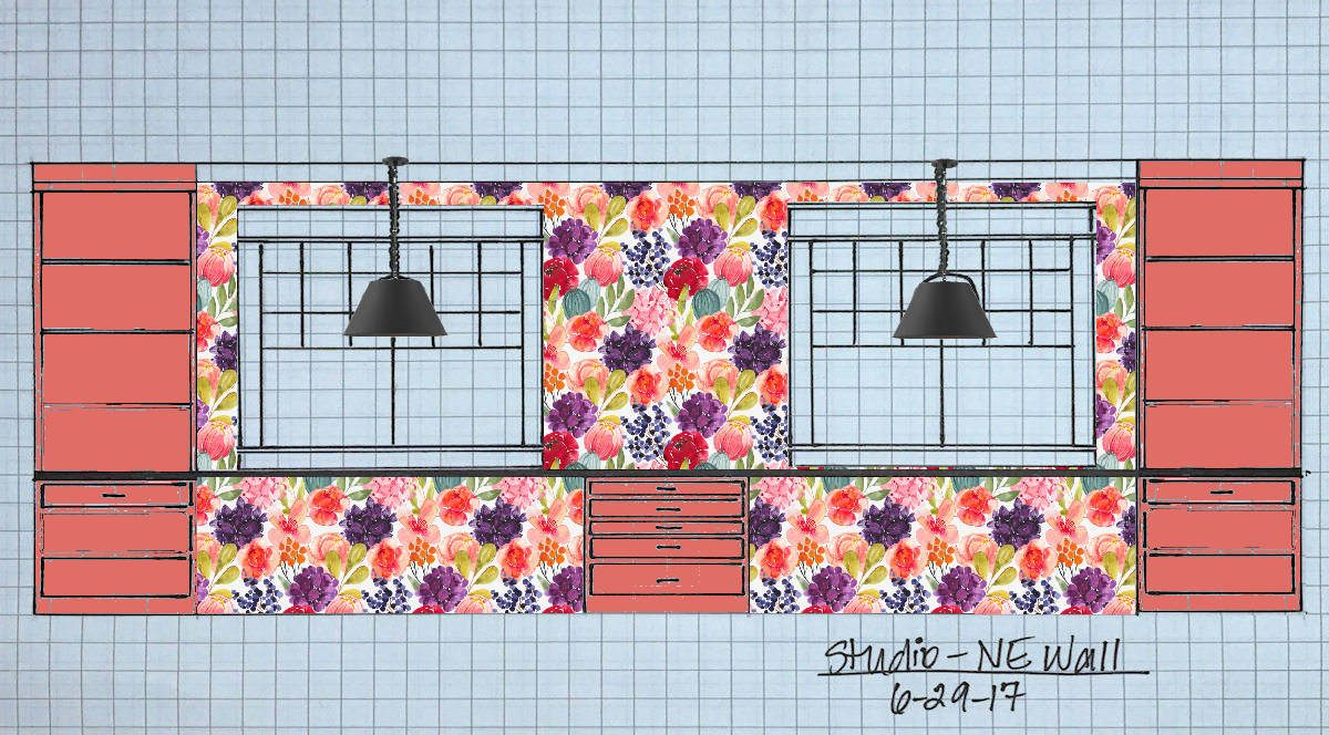 studio front wall with floral wallpaper coral cabinets and black pendant lights