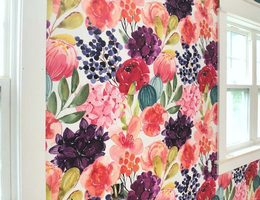 Bright and bold watercolor floral wallpaper from Spoonflower on main wall of studio - closeup