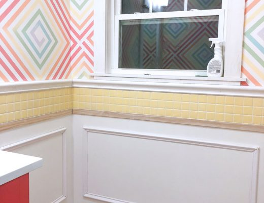 half bathroom walls with picture frame molding and baseboards installed
