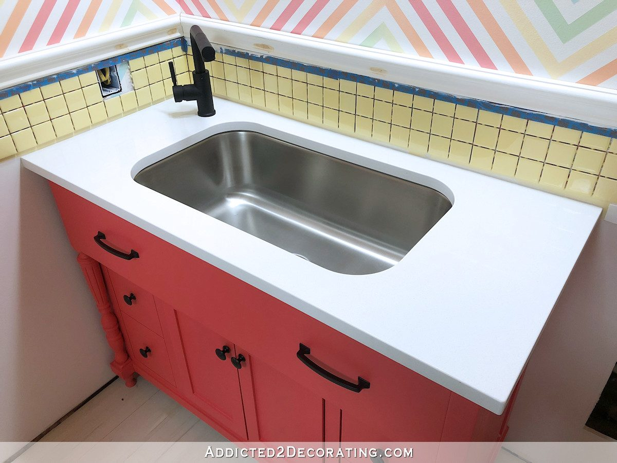 new snow white quartz countertop for half bathroom
