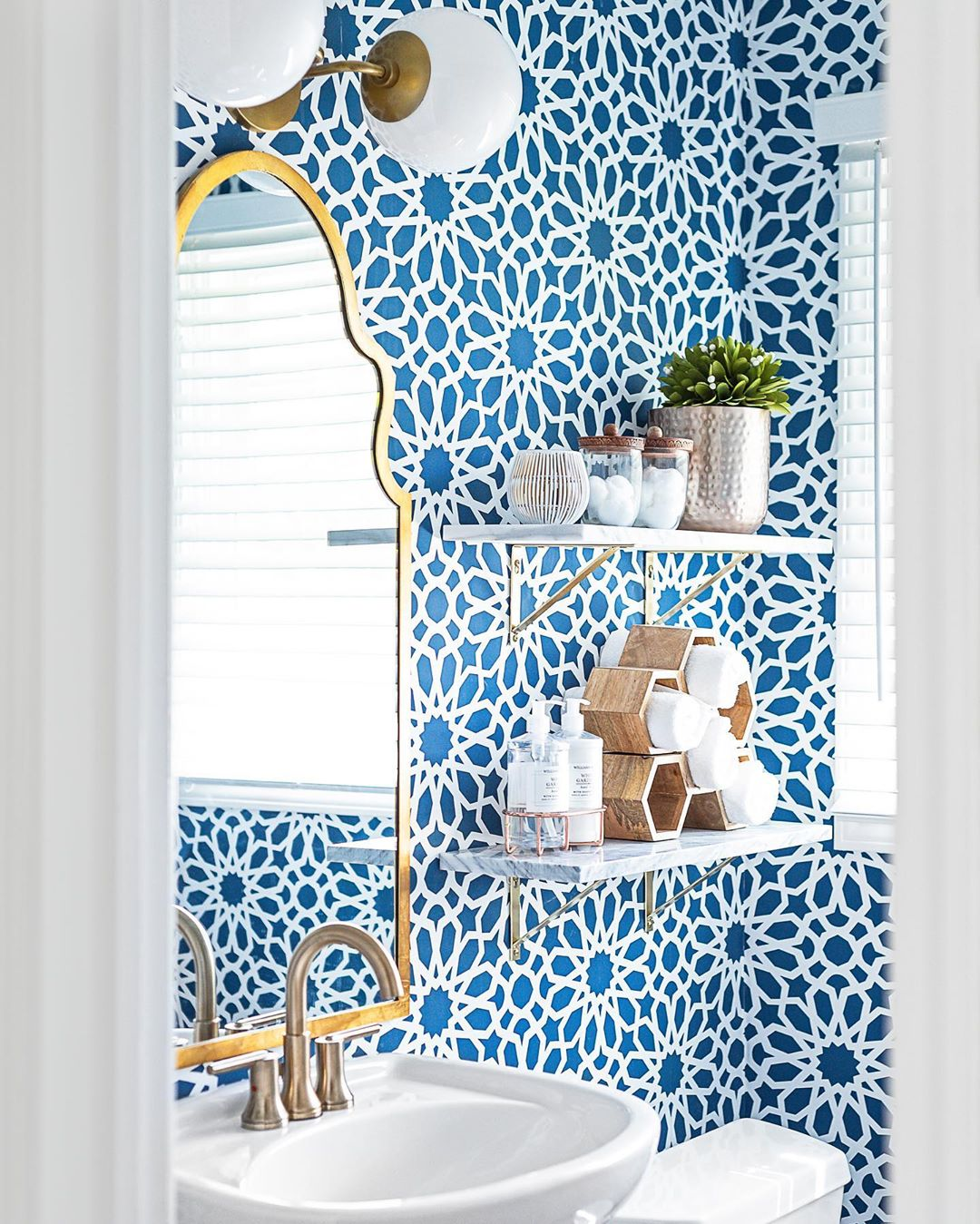 Bathroom with teal and white geometric wallpaper from Chad Esslinger Design (@chadesslingerdesign) on Instagram